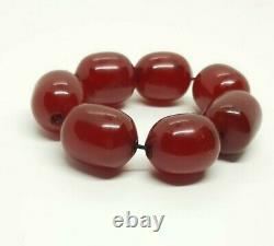 83.1 Grams Antique Faturan Cherry Amber 7 Big Beads Veins/Damari