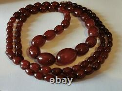 ANTIQUE CHERRY AMBER BAKELITE GRADUATED NECKLACE 124cm & 115g BEADS 10mm to 32mm
