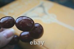 Antique graduated Cherry Amber necklace early 1900's 68.039 grams 30 inch long