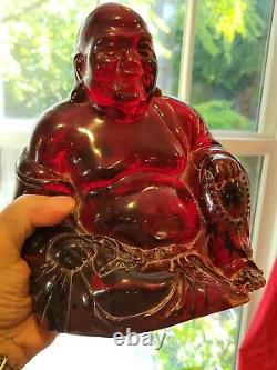 Chinese Carved Red Cherry Amber Buddha Figure on Wood Stand