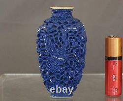 Rare 18th century Chinese Red-amber Crizzled Glass Snuff Bottle with wood stand